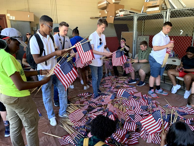 Attendees of the 2019 Youth of the Year Summit gather, roll and store American flags at the Fort Sam Houston Cemetery, San Antonio, June 19, 2019. During their week in Texas, about 60 teens from across the Air Force took part in a variety of activities focused on teambuilding, leadership, community service and personal growth. The week culminates June 20 when the Air Force Youth of the Year will be named. The winner goes on to compete for Military Youth of the Year in September. The Air Force, through the Air Force Services Center, partners with the Boys and Girls Clubs of America to offer the Youth of the Year program. (U.S. Air Force photo by Debbie Aragon)