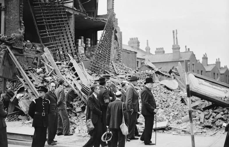 Winston_Churchill_visiting_bomb-damaged_areas_of_the_East_End_of_London_8_September_1940._H3978-e1504037952277