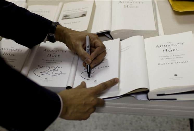 Barack_Obama_signs_copies_of_The_Audacity_of_Hope_2-9-09