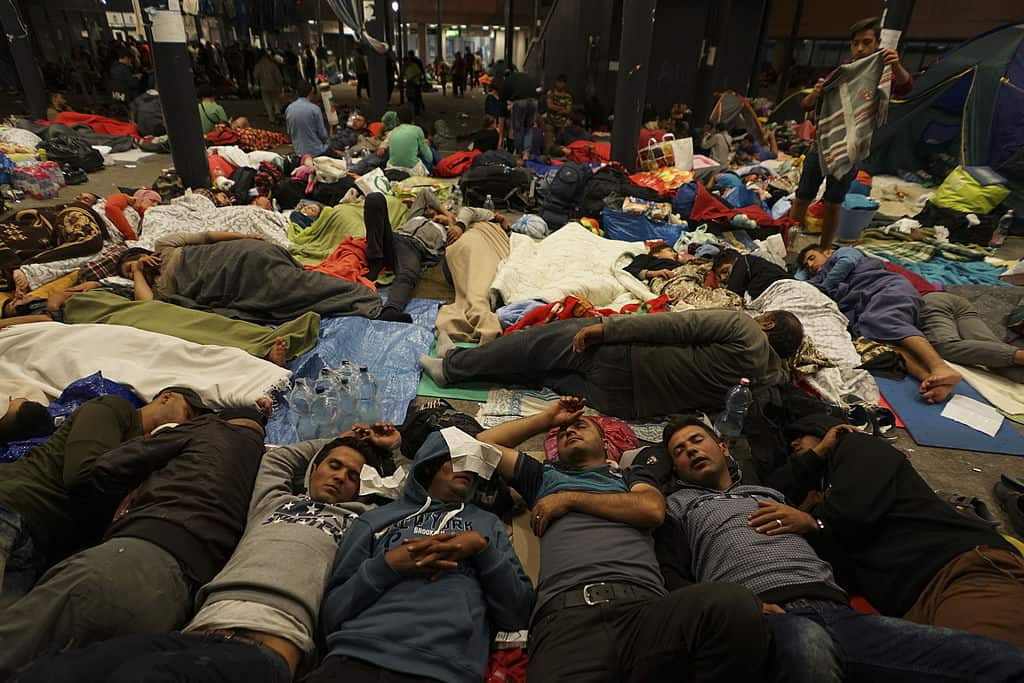 Syrian_refugees_having_rest_at_the_floor_of_Keleti_railway_station._Refugee_crisis._Budapest,_Hungary,_Central_Europe,_5_September_2015