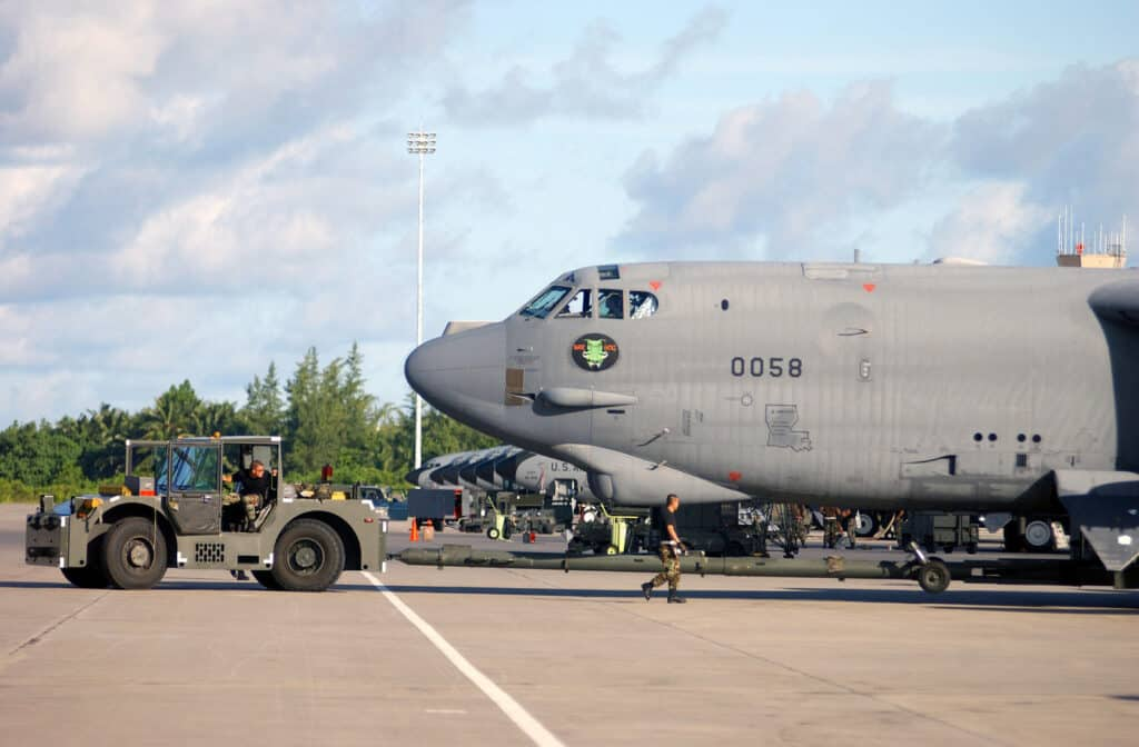 US Air Force (USAF) members of the 40th Air Expeditionary Wing (AEW) use a MB-2 aircraft two tractor to park a USAF B-52H Stratofortress bomber, 93rd Bomb Squadron (BS), Barksdale Air Force Base (AFB), Louisiana (LA), after a successful combat sortie.  The B-52 bombers were part of the A-day Shock and Awe campaign starting Operation IRAQI FREEDOM.