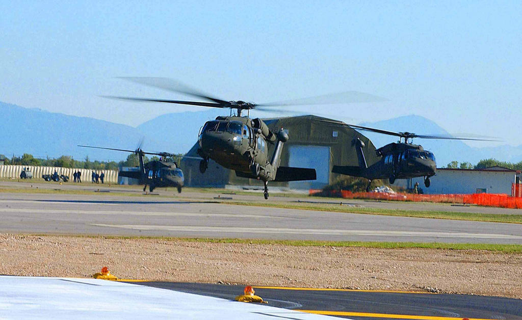 US Army (USA) UH-60 Black Hawk helicopters assigned to Bravo/Company, 5/158th Aviation Regiment, take off from the flight line at Aviano Air Base (AB), Italy, in preparation for a Joint Training Exercise with the Polish Armed Forces called Exercise VICTORY STRIKE III.